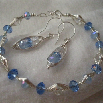 Faceted Glass Crystals with Herringbone Weave